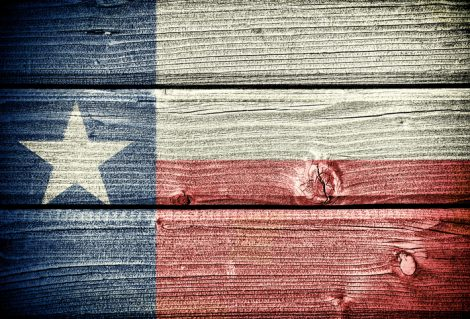flag of  Texas painted on old grungy wooden  background