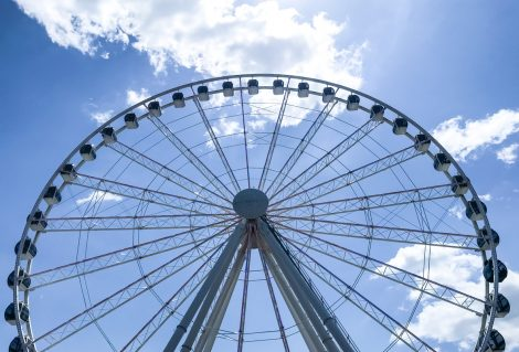 Picture of a Ferris Wheel.   Like a Giant fortress against a blue sky, this Ferris wheel offered enjoyment for all.