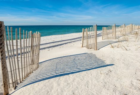 Empty white sandy beach with fences,  Gulf of Mexico coast, Alabama, USA
