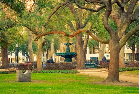 Photo of Bienville Square, a historic city park with an old ornate fountain in downtown Mobile, Alabama, USA