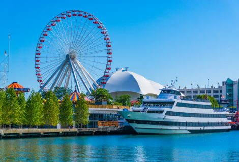 Chicago's Navy Pier and ferris wheel along the Chicago River with cruise ship; Illinois